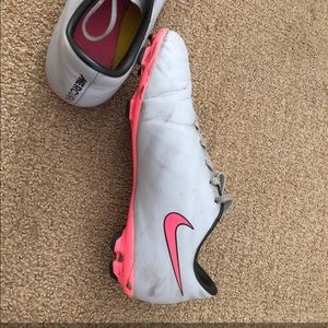Grey and pink nike cleats